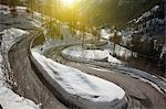 Winding road in snowy landscape Stock Photo - Premium Royalty-Free, Artist: Robert Harding Images, Code: 649-05951163
