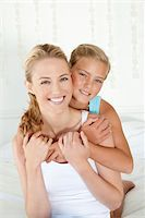 Portrait of Mother And Daughter Embracing Stock Photo - Premium Royalty-Freenull, Code: 6106-05951494