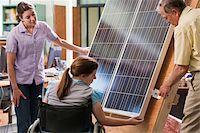 solar panel usa - Professor explaining mounting of photovoltaic module to engineering students Stock Photo - Premium Royalty-Freenull, Code: 6105-05953700