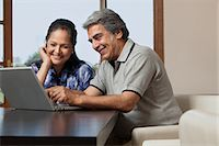 Old couple with a laptop Stock Photo - Premium Royalty-Freenull, Code: 614-05955290