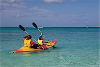 extremism - Two people kayaking in Caribbean sea, Grand Cayman, Cayman Islands Stock Photo - Premium Royalty-Freenull, Code: 614-05955468