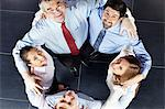Colleagues with arms around each other Stock Photo - Premium Royalty-Freenull, Code: 614-05955533