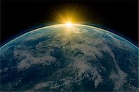 space - Sunrise over planet earth Stock Photo - Premium Royalty-Freenull, Code: 614-05955544