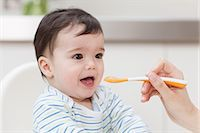 Baby boy being fed Stock Photo - Premium Royalty-Freenull, Code: 614-05955634