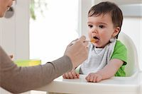 Mother feeding baby son Stock Photo - Premium Royalty-Freenull, Code: 614-05955648