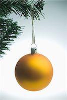 Yellow christmas bauble hanging on tree Stock Photo - Premium Royalty-Freenull, Code: 614-05955767