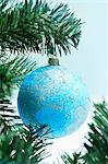 Globe bauble on christmas tree Stock Photo - Premium Royalty-Free, Artist: Blend Images, Code: 614-05955799