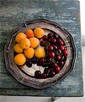 Apricots and cherries on silver tray