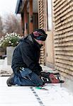 Man working outside house Stock Photo - Premium Royalty-Free, Artist: Ikon Images, Code: 6102-05955912