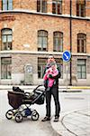 Father and daughter (0-11 months) in downtown with stroller Stock Photo - Premium Royalty-Free, Artist: Ikon Images, Code: 698-05956101