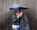Two women under one umbrella Stock Photo - Premium Royalty-Free, Artist: Science Faction, Code: 698-05956495