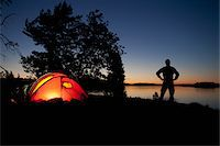 Man and tent Stock Photo - Premium Royalty-Freenull, Code: 698-05957525