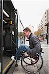 Man in wheelchair rolling in the bus Stock Photo - Premium Royalty-Free, Artist: Siephoto, Code: 698-05957670