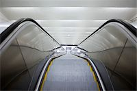 High angle view of a long escalator Stock Photo - Premium Royalty-Freenull, Code: 698-05957684