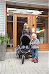 Mother and daughter (2-3) in front of house with baby carriage Stock Photo - Premium Royalty-Free, Artist: F1Online, Code: 698-05957749