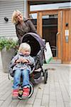 Mother pushing baby (2-3) carriage in front of house Stock Photo - Premium Royalty-Free, Artist: F1Online, Code: 698-05957752