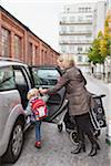 Mother helping daughter (2-3) to get into car Stock Photo - Premium Royalty-Free, Artist: KL Services, Code: 698-05957755