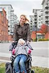 Portrait of smiling mother and daughter (2-3) Stock Photo - Premium Royalty-Free, Artist: Ikon Images, Code: 698-05957823
