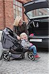 Woman and her daughter (2-3) near car Stock Photo - Premium Royalty-Free, Artist: Ikon Images, Code: 698-05957824