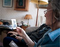 Older couple looking at photo Stock Photo - Premium Royalty-Freenull, Code: 698-05958968