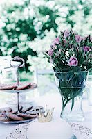 Birthday cake with flower pot on table Stock Photo - Premium Royalty-Freenull, Code: 698-05959164