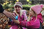 Girls taking a break in forest Stock Photo - Premium Royalty-Free, Artist: RelaXimages, Code: 698-05959179
