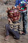 Young boy holding large carved wooden mask to his face at the Tamshing Phala Choepa Tsechu, near Jakar, Bumthang, Bhutan, Asia Stock Photo - Premium Rights-Managed, Artist: Robert Harding Images, Code: 841-05959788