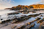 Eroded ledges exposed at low tide, Sandymouth, North Cornwall, England, United Kingdom, Europe Stock Photo - Premium Rights-Managed, Artist: Robert Harding Images, Code: 841-05962548