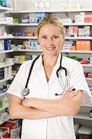 Female pharmacist standing by shelves in pharmacy Stock Photo - Premium Royalty-Freenull, Code: 618-05962966