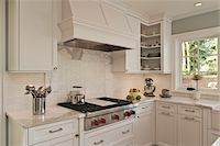 stove - Kitchen interior with marble countertop. Stock Photo - Premium Royalty-Freenull, Code: 618-05963290