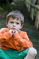 sad child sitting - Portrait of Boy on Steps Stock Photo - Premium Royalty-Freenull, Code: 600-05969983