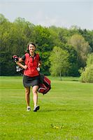 Woman Carrying Golf Bag Stock Photo - Premium Rights-Managednull, Code: 700-05969957