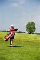 Woman Carrying Golf Bag Stock Photo - Premium Rights-Managednull, Code: 700-05969966