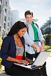 Students using laptop together outdoors Stock Photo - Premium Royalty-Free, Artist: Ron Fehling, Code: 635-05971448