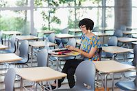 expectation - Student using laptop in classroom Stock Photo - Premium Royalty-Freenull, Code: 635-05971453