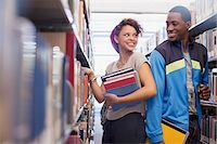 flirting - Students talking in library Stock Photo - Premium Royalty-Freenull, Code: 635-05971455