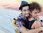 Students hugging on bleachers Stock Photo - Premium Royalty-Free, Artist: Blend Images, Code: 635-05971496