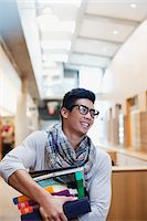 Student carrying stack of books in library Stock Photo - Premium Royalty-Freenull, Code: 635-05971520