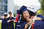 Smiling graduates hugging outdoors Stock Photo - Premium Royalty-Free, Artist: Ikon Images, Code: 635-05971530