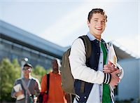 Student carrying folders outdoors Stock Photo - Premium Royalty-Freenull, Code: 635-05971546