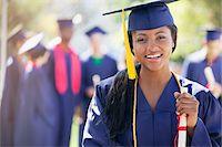 Smiling graduate holding diploma Stock Photo - Premium Royalty-Freenull, Code: 635-05971557