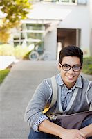 Smiling student sitting outdoors Stock Photo - Premium Royalty-Freenull, Code: 635-05971560