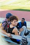 Students sitting together on bleachers Stock Photo - Premium Royalty-Free, Artist: Blend Images, Code: 635-05971576