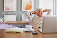 Older man using laptop in cafe Stock Photo - Premium Royalty-Freenull, Code: 635-05971712