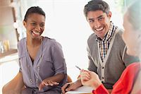 Smiling business people working together Stock Photo - Premium Royalty-Freenull, Code: 635-05971732