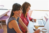 Businesswomen working together in cafe Stock Photo - Premium Royalty-Freenull, Code: 635-05971734
