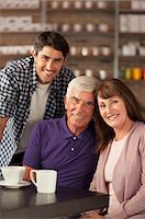Smiling family sitting in cafe Stock Photo - Premium Royalty-Freenull, Code: 635-05971736