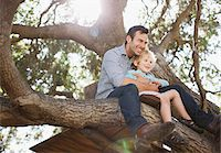 Father and son hugging in tree Stock Photo - Premium Royalty-Freenull, Code: 635-05971754