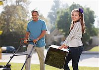 Father and daughter mowing lawn together Stock Photo - Premium Royalty-Freenull, Code: 635-05971765