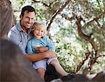 Father and son sitting in tree Stock Photo - Premium Royalty-Free, Artist: Water Rights, Code: 635-05971778